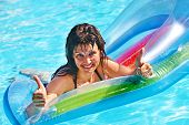 picture of mattress  - Happy woman  swimming on inflatable beach mattress - JPG