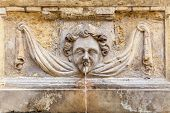 stock photo of cherub  - An ancient cherub fountain on the island of Malta - JPG