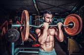 stock photo of muscle builder  - bodybuilder in training room  - JPG