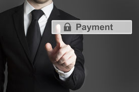image of payment methods  - businessman in suite pressing touchscreen payment lock symbol - JPG