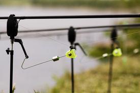stock photo of swingers  - Warning for fishing rod equipment swinger closeup - JPG