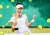 picture of won  - Girl tennis player won the cup at the sport competition - JPG