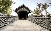 stock photo of covered bridge  - Wooden Covered Bridge Guelph Ontario over eramosa river