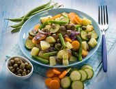 stock photo of steam  - steamed mixed vegetables with capers - JPG