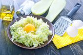 image of marrow  - grated marrow with raw egg on plate - JPG