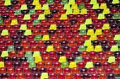 picture of tribunal  - Detail with empty colored sports arena tribunes on a football stadium - JPG