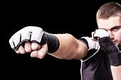 pic of kickboxing  - a young kickboxer or boxer isolated over a black background - JPG