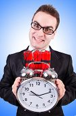 foto of time-bomb  - Man with time bomb isolated on white - JPG