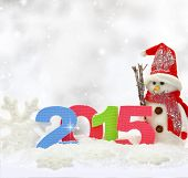 foto of snowmen  - Snowman and new year 2015 on snow - JPG