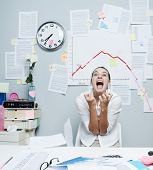 picture of insane  - Shocked businesswoman screaming under financial negative diagram with arrow going down - JPG