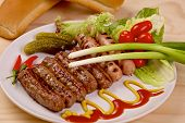 pic of scallion  - Grilled sausages with red hot chilli peppers - JPG