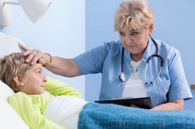 picture of high fever  - Ill boy having high fever and his doctor  - JPG