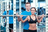 stock photo of barbell  - Working out legs exercises - JPG