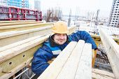 foto of millwright  - construction site worker at concrete works at building area  - JPG