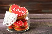 pic of glass heart  - Heart shaped cookies for valentines day in glass jar on color wooden background - JPG