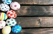 foto of lie  - Easter eggs lying in a basket - JPG