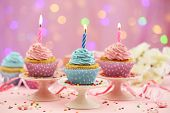 pic of cupcakes  - Delicious cupcakes on table on bright background - JPG