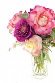 picture of special day  - A clear vase of beautiful home grown roses and lilac blooms on a white background with plenty of space for text perfect for Mothers Day or special occasions - JPG