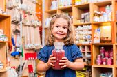 stock photo of pigment  - Child with color or paint pigments in store - JPG