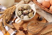 pic of chicken-wire  - Eggs and wheat on wooden table - JPG