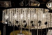 image of chandelier  - Contemporary glass chandelier isolated over black background - JPG