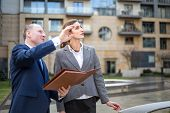 image of presenting  - Real estate agent presenting a new apartment  - JPG