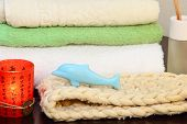 image of bast  - Towel stack bast and soap in the form of a dolphin - JPG
