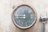pic of manometer  - Old Manometer on wooden table workshop and wrench - JPG