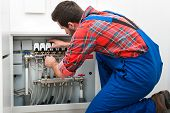 image of floor heating  - Technician servicing the underfloor heating - JPG