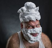 stock photo of shaved head  - Funny man with shaving foam covered face - JPG