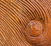 stock photo of woodcarving  - Carved Whirlpool on Wood Texture Brown Background - JPG