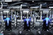 image of motor vehicles  - Engine with metal and chrome parts of the automobile motor with three blue lights - JPG
