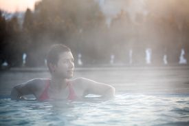 picture of thermal  - Happy young woman relaxing in thermal pool. ** Note: Visible grain at 100%, best at smaller sizes - JPG