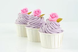 image of sugarpaste  - sweet dessert cupcakes on white background clearly - JPG