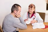 stock photo of taboo  - A man is being advised by a doctor to incontinence - JPG