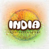 stock photo of ashoka  - Stylish text India in front of Ashoka Wheel on shiny floral design decorated green and saffron color splash background for Independence Day celebration - JPG