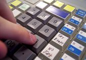 foto of cash register  - a cashier pushing buttons on a cash register - JPG