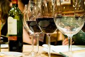 stock photo of restaurant  - Four glasses of wine set in the restaurant - JPG