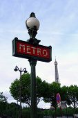 image of gare  - Sign for the Paris Metro with the Eiffel Tower in the background - JPG