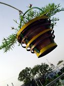 foto of muharram  - A hanging flower pot in the background of sky at the historic chota imambada of Lucknow - JPG