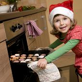 stock photo of christmas cookie  - Little girl baking christmas cookies - JPG