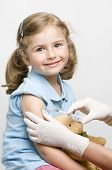 stock photo of polio  - A doctor giving a child an injection - JPG