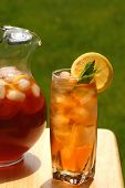 Glass Of Iced Tea With Pitcher Of Tea Next To It