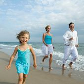 image of children beach  - Happy family playing at the beach - JPG