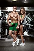 Beautiful Young Sporty Sexy Couple In Gym poster