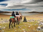 Horseriders in mongolian wilderness