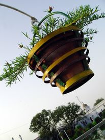 stock photo of muharram  - A hanging flower pot in the background of sky at the historic chota imambada of Lucknow - JPG