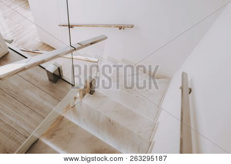 poster of Fashion Workplace. Staircase With Marble Steps. Fashion Salon. Luxury Design. White Interior In Salo