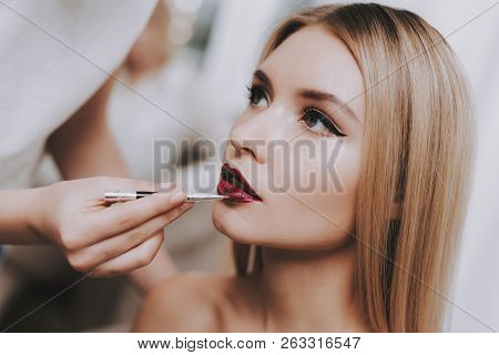 poster of Blond Girl In Beauty Salon. Makeup In Beauty Salon. Woman Colors Lips. Woman And Makeup Artist. Beau