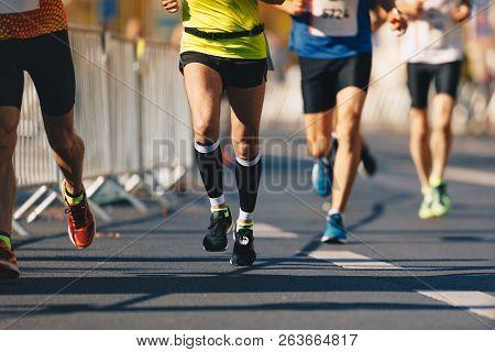 poster of Marathon Running Race, People Feet On Autumn Road. Runners Run Urban Marathon In The The City